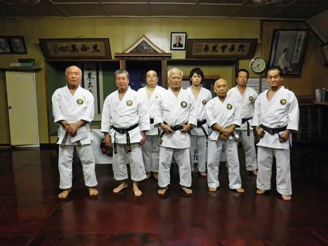 Back row Mr. Funakoshi 2nd Dan, Mr. Miyaguni 3rd Dan and Mr. Yamazato Kyoshi 8th Dan. Front row; Tome sensei, Taira sensei, Arakaki sensei, Shinjo sensei and Miyagi sensei (five judges)