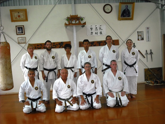 First Row: Gerard Cappiello Renshi 6th dan, Tome sensei Hanshi 9th dan, Steve will 5th dan and Mastin Scott Renshi 6th dan. Second row; Laurie Gneiding 2nd dan, Zach Parr 2nd dan, Kise Jyoma brown belt, Masaru Okuma 4th dan, Lora Wert 2nd dan & Carly Aulicky 3rd dan.