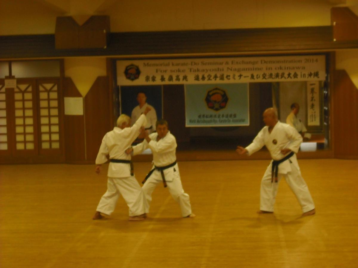 Kusanku kata bunkai by three top directors from left to right, Toshimitsu Arakaki hanshi 10th dan , Yoshitaka Taira hanshi 10th dan & Iwao Tome hanshi 9th dan.